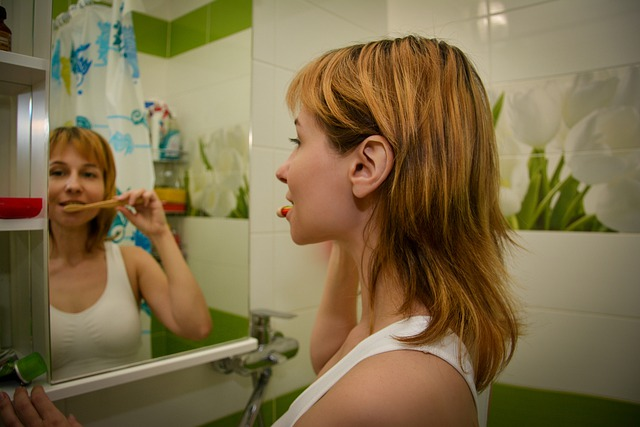 woman's oral health routine and teeth brushing
